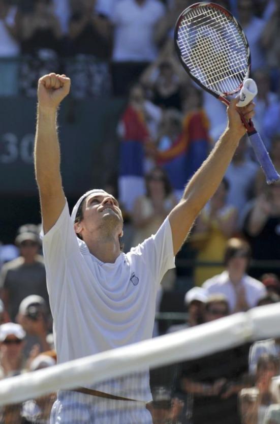 Hass celebra la victoria frente a Noval Djokovic